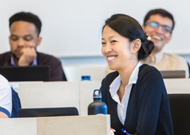 Female student laughs during lecture